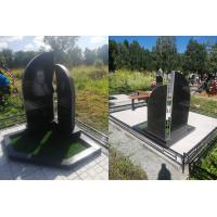 Памятник фигурный из Карельского гранита (свеча)